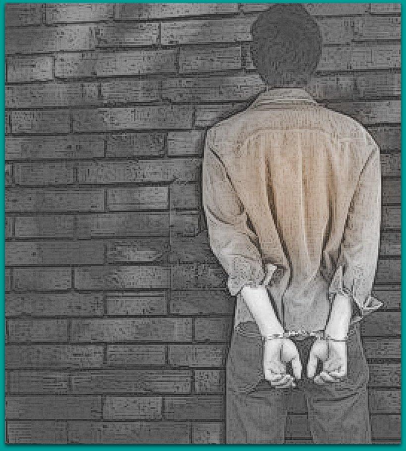 handcuffed-man-border